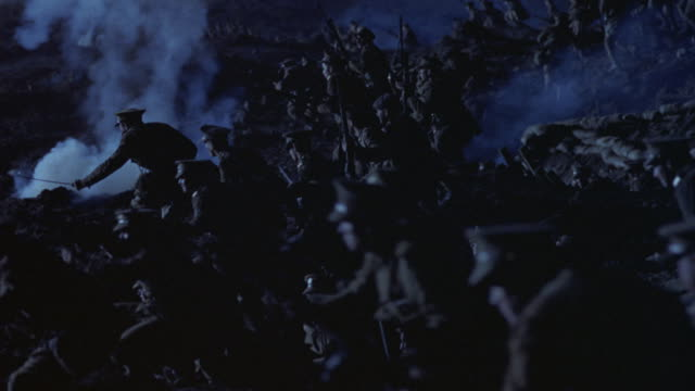 soldiers huddle in a trench and run towards the enemy. - conflict stock videos & royalty-free footage