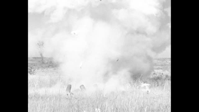 soldiers in a field at edgewood arsenal at aberdeen proving ground as they place explosives in shells / close shot of shells being filled / shell... - 動物の殻点の映像素材/bロール