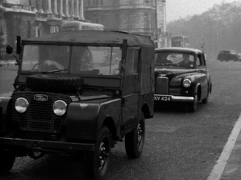 soldiers in a jeep use a pedometer to measure the distance along the mall in preparation for the coronation of elizabeth the second 1953 - 1953 stock videos and b-roll footage