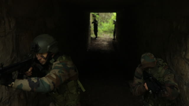soldiers in abandoned tunnel - mercenary human role stock videos & royalty-free footage