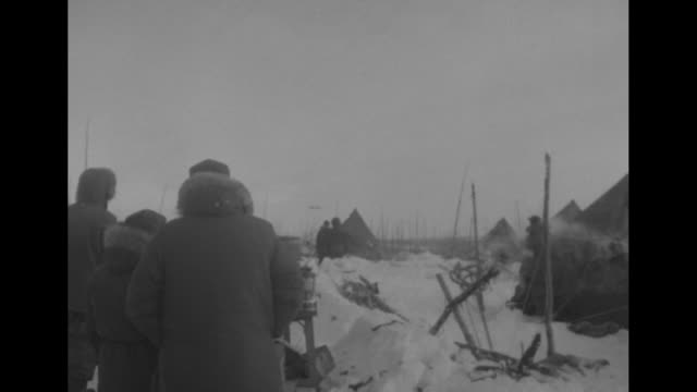 soldiers in anoraks unloading supplies from sled equipping surrounding tents / soldier holding axe at sled searching through supplies tents in bg /... - whitehorse stock videos and b-roll footage