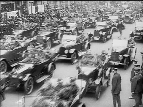 B/W 1918 soldiers in cars driving in Victory Parade on Fifth Avenue / end of World War I / NYC