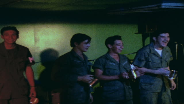 ZO Soldiers in club audience drinking and watching performance / Da Nang Vietnam