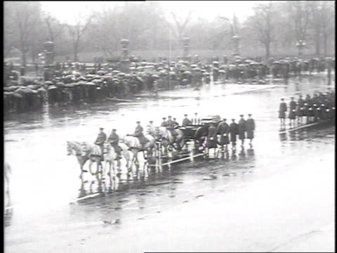 soldiers in formation marching / horsedrawn caisson carrying casket with accompanying soldiers on foot and cavalry / funeral procession to church - funeral procession stock videos & royalty-free footage