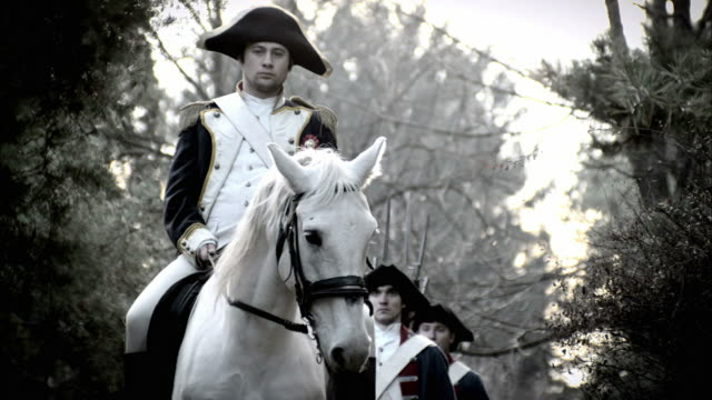 soldiers in french revolution uniforms march behind a white horse with a mounted military officer. - french revolution stock videos & royalty-free footage