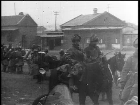 soldiers in fur hats riding horses past standing soldiers / japan invading manchuria - manchuria stock videos & royalty-free footage