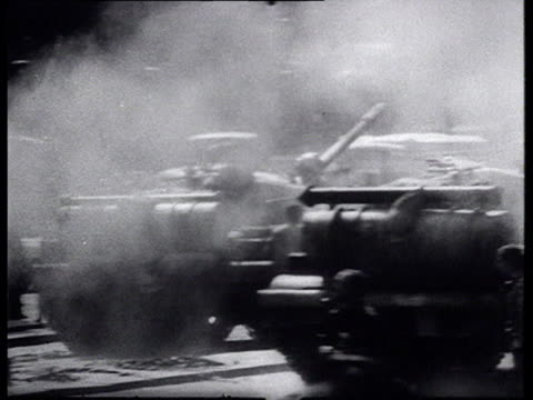 soldiers in soviet tanks driving through city people in streets watching and shouting at tanks crowd walking in demonstration injured people talking... - 1968年点の映像素材/bロール