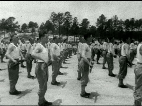 soldiers in tee shirts amp uniform drilling in open field exercising drills w/ rifles british prime minister churchill standing on drill instructor... - drill instructor stock videos & royalty-free footage