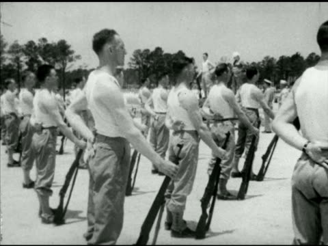 stockvideo's en b-roll-footage met soldiers in tee shirts uniform drilling in open field exercising drills w/ rifles british prime minister churchill standing on drill instructor... - 1942