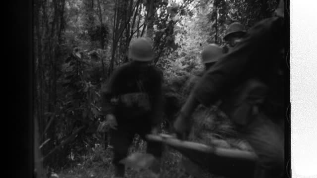 soldiers in the japanese army cut through a jungle; planes fly above a japanese air base. - stillahavsöarna bildbanksvideor och videomaterial från bakom kulisserna