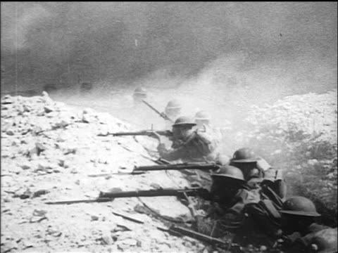 b/w 1917/18 soldiers in trenches with gas masks firing rifles as smoke billows above / ww i / newsreel - prima guerra mondiale video stock e b–roll
