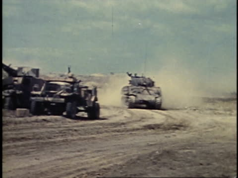 soldiers in truck passing tank on a dusty road / iwo jima japan - schlacht um iwojima stock-videos und b-roll-filmmaterial