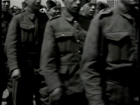 f soldiers in uniform marching down street men seated at dinning hall eating man in white coat taking plates two uniformed men eating cu poster 'join... - 1940 stock videos & royalty-free footage