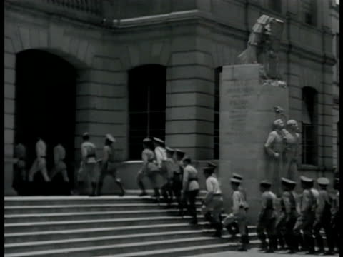 soldiers in uniform walking up steps into building. int soldier taking notes at desk. ext mexican soldiers full gear & rifle marching down street... - mexican ethnicity stock videos & royalty-free footage