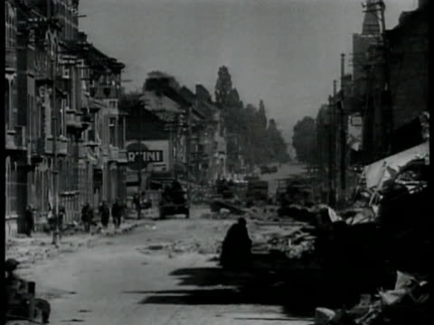 soldiers in vehicles driving through war-torn town debris collapsed building. b.e.f. soldiers in open tank driving pass town. xws dunkirk in flames... - allied forces stock videos & royalty-free footage