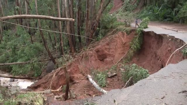 soldiers in zimbabwe assess road damage in the aftermath of cyclone idai and hand out food to victims - cyclone stock videos and b-roll footage
