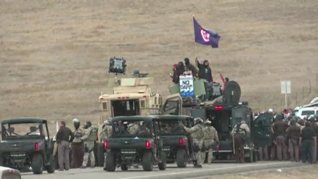 soldiers jeeps and a crowd gathered at the standing rock indian reservation in protest for the dakota access pipeline - north american tribal culture stock videos & royalty-free footage