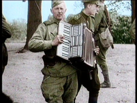 soldiers jokingly dances for his peers / the crowd watches smiling / a uniformed man plays the accordion for the camera / a boat ferries some of the... - river elbe stock videos & royalty-free footage