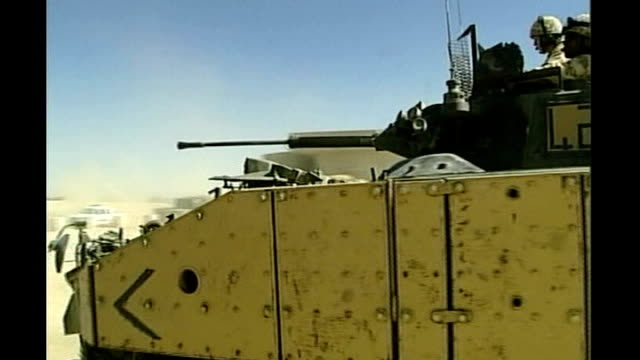 soldiers killed near basra; iraq: tanks along and soldiers along in armoured fighting vehicle soldier holding rifle military vehicles along in desert... - military land vehicle stock videos & royalty-free footage