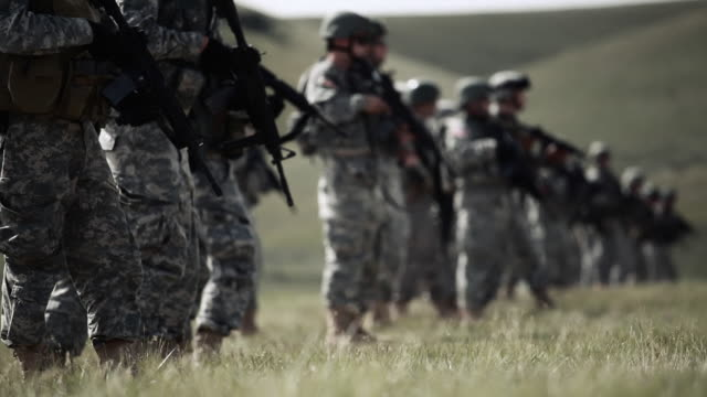 soldiers kneel to fire rifles - us military stock videos & royalty-free footage