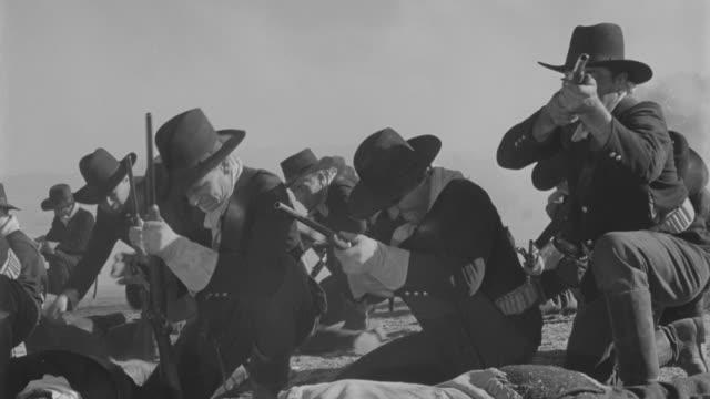 ms soldiers kneeling and firing rifles - 銃撃事件点の映像素材/bロール