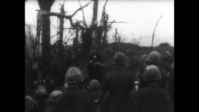 soldiers kneeling down in the jungle arrange an altar on an ammunition box / chaplain reads / soldiers take communion / troop ship travels down the... - altar stock videos & royalty-free footage