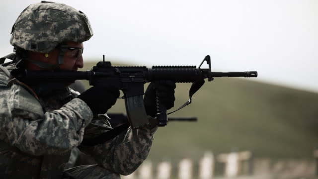 Soldiers kneeling to fire at targets