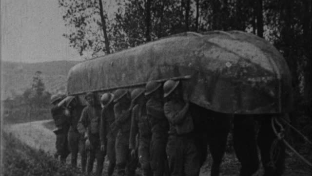 soldiers launch boat to get across river / france - 1917 stock-videos und b-roll-filmmaterial