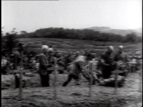 soldiers laying flowers in front of fresh wooden cross marked graves / germany - 1918 stock videos and b-roll footage