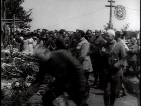 soldiers laying flowers on graves / germany - 1918 stock videos & royalty-free footage