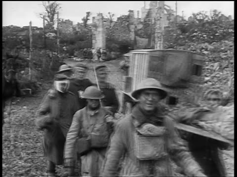 vidéos et rushes de soldiers leading german pow's on road / some bandaged, one wounded carried / france - soldat