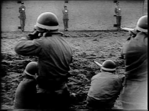 soldiers leading manfred pernass, gunther billing and wilhelm schmidt to firing line / view of prisoners and soldiers through barbed wire fence /... - hinrichtung stock-videos und b-roll-filmmaterial