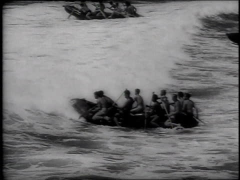 stockvideo's en b-roll-footage met montage soldiers learning to launch rubber rafts from the shore / pacific theater of operations - 1943