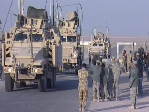 us soldiers leave iraq crossing the border to kuwait - iraq stock videos and b-roll footage