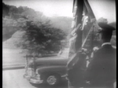 stockvideo's en b-roll-footage met soldiers line the road as general lucius clay rides in a car during his retirement ceremony at fort myer virginia - fort myer