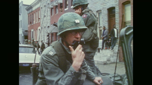 stockvideo's en b-roll-footage met soldiers line the streets control crowds and coordinate response on streets of baltimore - demonstrant