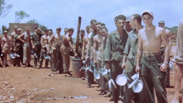 soldiers lining up to clean their mess kits in a barrel of water / guam mariana islands - グアム点の映像素材/bロール