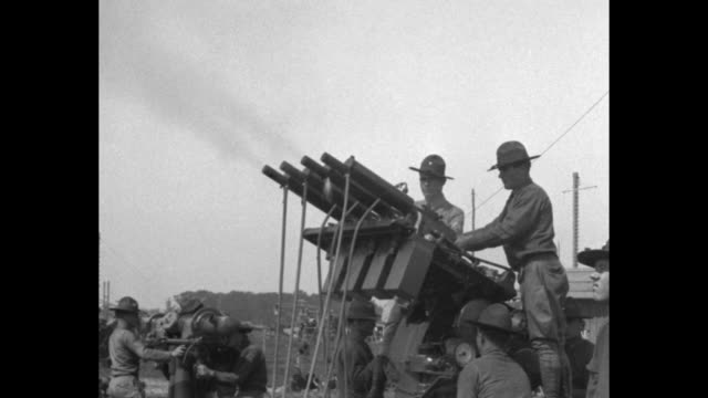 soldiers loading and firing anti-aircraft gun during weapons tests at aberdeen proving ground / soldiers firing anti-aircraft machine guns mounted in... - anti aircraft stock videos & royalty-free footage