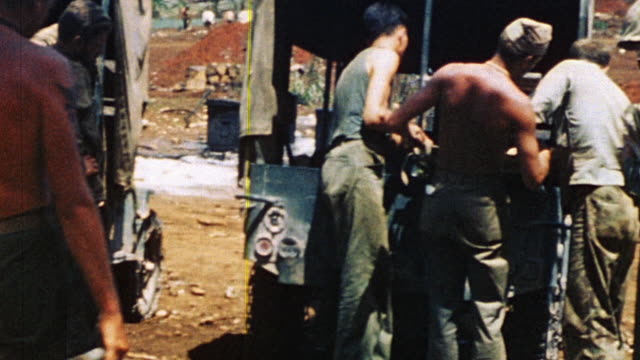 soldiers loading casualties on stretchers into military ambulance and watching as it drives away / saipan mariana islands - saipan stock videos and b-roll footage