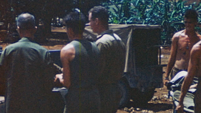 ts soldiers loading empty stretchers into military ambulance at us army field hospital / saipan mariana islands - mariana islands stock videos and b-roll footage