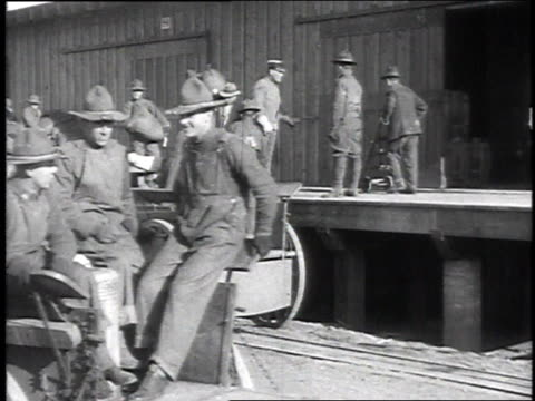soldiers loading unspecified goods into horsedrawn carts / camp sherman chillicothe ohio united states - chillicothe stock videos & royalty-free footage
