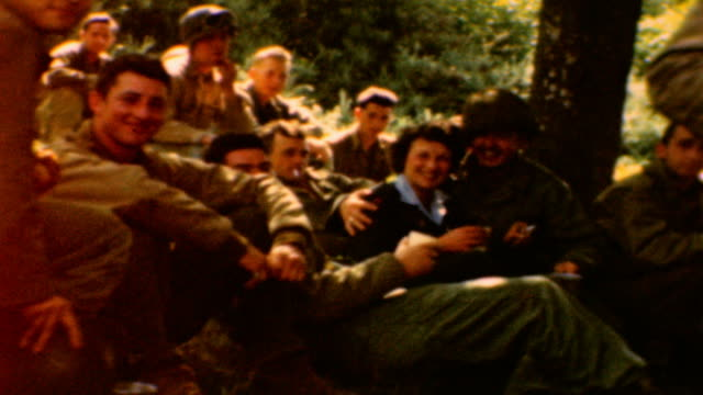/ soldiers lounge around red cross clubmobile / lt. david towns has his arm around mary haynsworth mathews / a medic goofs around and checks marys... - allied forces stock videos & royalty-free footage