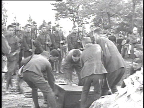 soldiers lowering a casket into the ground / france - lowering stock videos & royalty-free footage