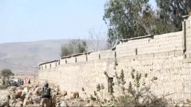 soldiers loyal to president of yemen abd rabbuh mansur hadi take security measures around the 312th brigade quarters after taking its control from... - 多国籍軍点の映像素材/bロール