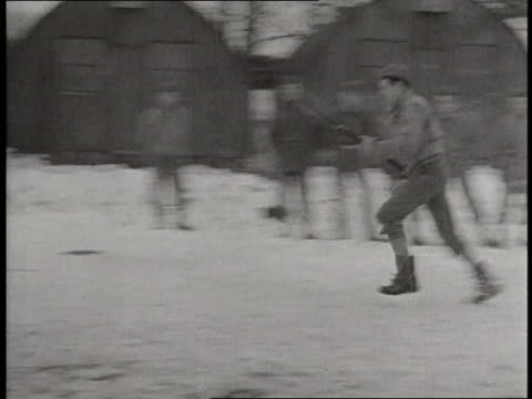 Soldiers make Adolf Hitler snowmen then run and stab the snowmen with bayonets