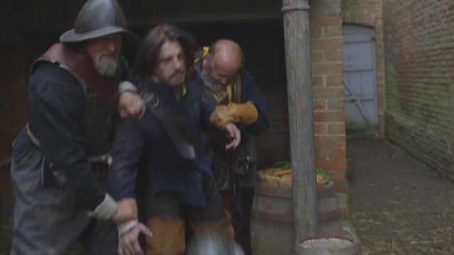 soldiers make an arrest - tudor/elizabethan era reenactment - helmet stock videos & royalty-free footage