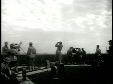 Soldiers manning antiaircraft station cannon air raid warden w/ binoculars looking into the sky HA WS Cityscape WWII