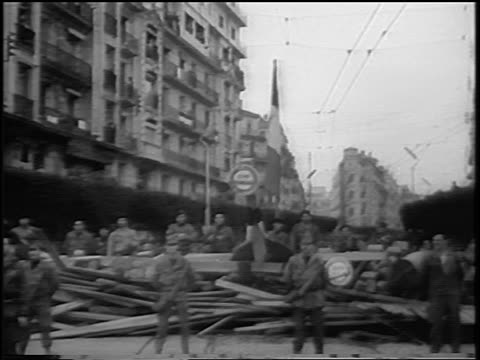 B/W 1960 soldiers manning barriacde on street in Zone Bleue / Algeria / newsreel
