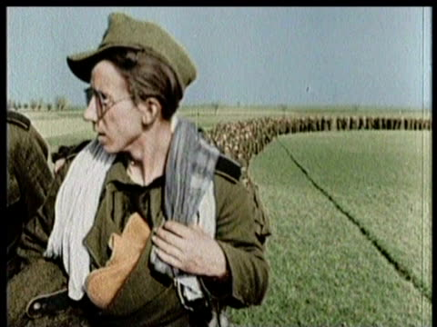 soldiers march across field / tanks arrive in town / battalion of tanks - world war ii stock videos & royalty-free footage
