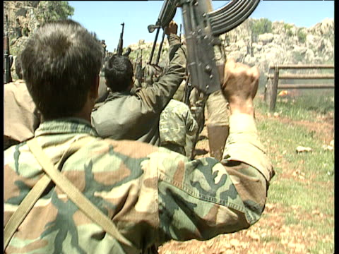 pkk soldiers march and chant with ak 47's held in the air lebanon 1991 - kurdistan workers party stock videos & royalty-free footage